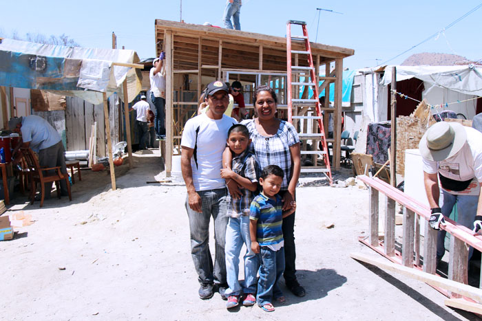 house_building_and_Mexican_family