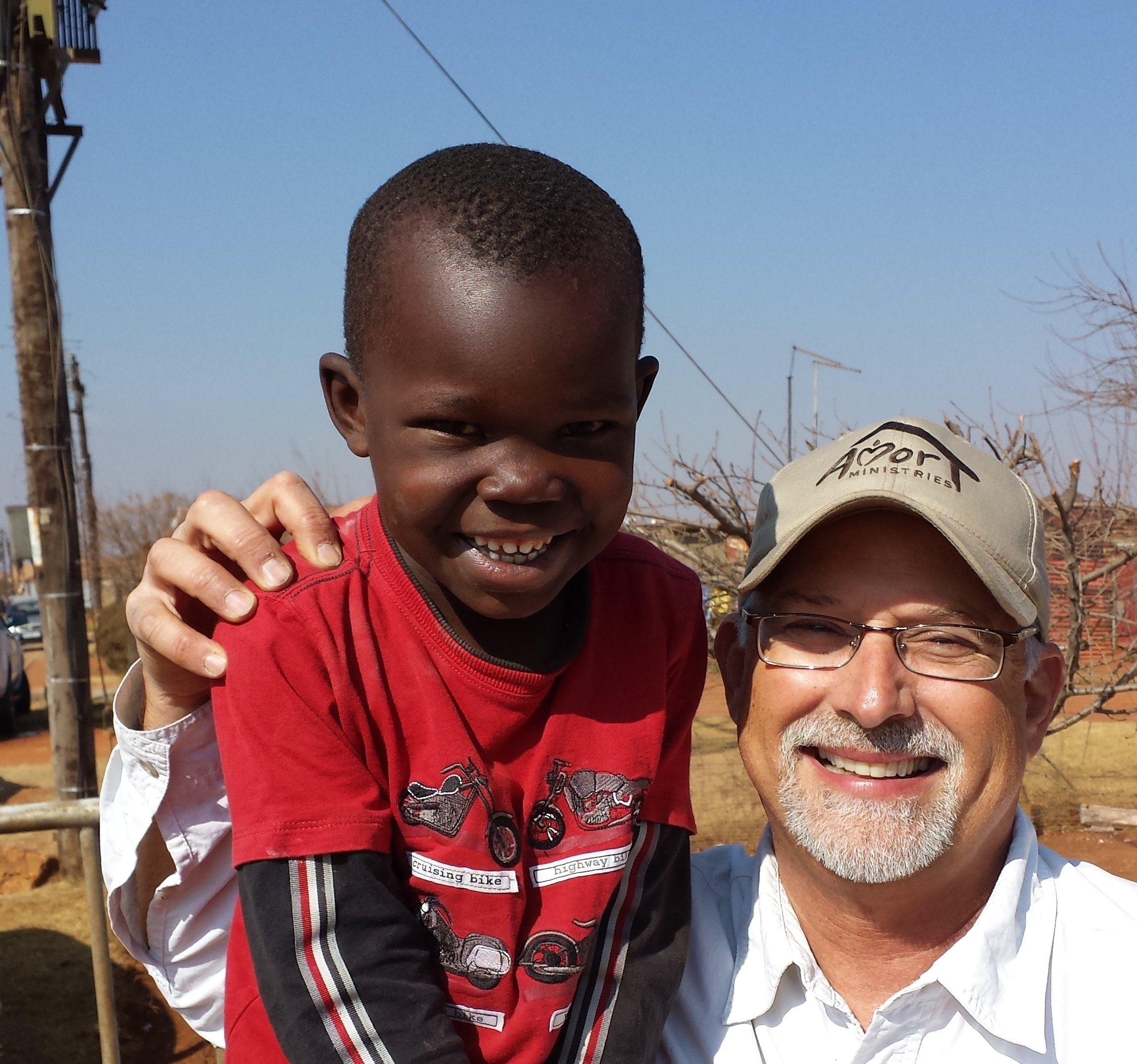 Scott_with_boy_in_South_Africa