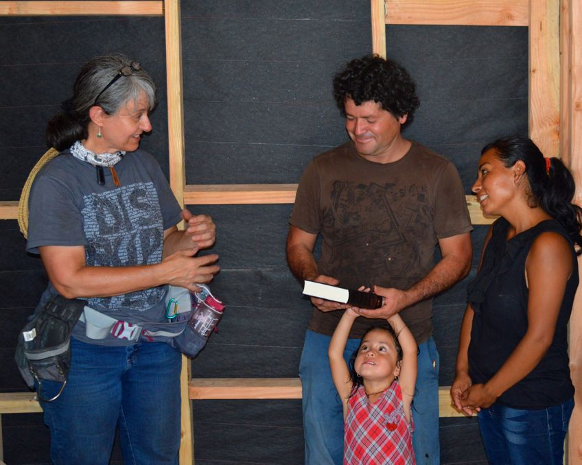 Pastor_Diane_during_house_dedication_with_receipient_family