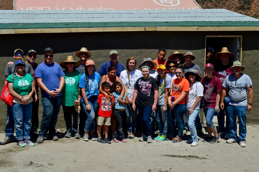 Paola_and_the_group_from_John_Knox_Presbyterian_in_front_of_thei_new_home