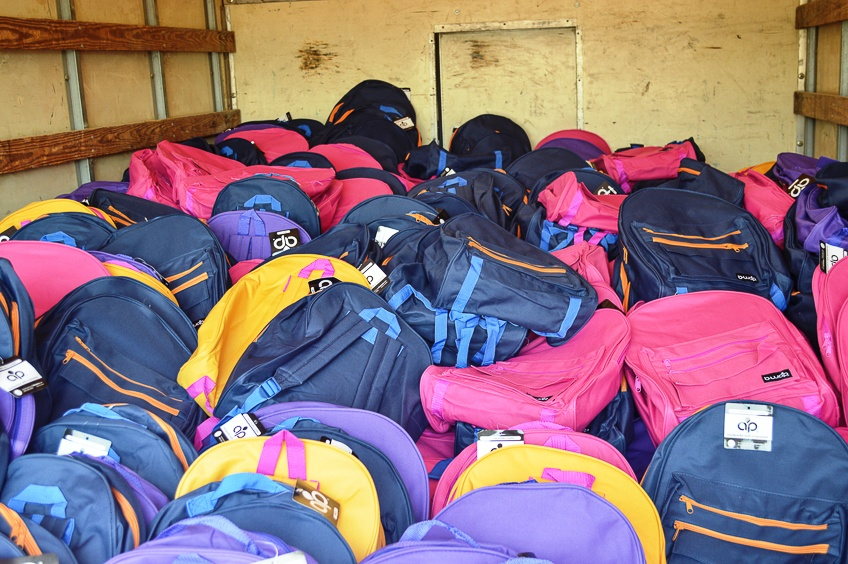 truck_filled_with_backpacks