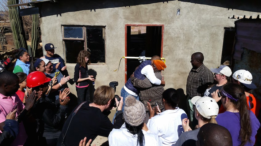 hug_during_key_ceremony_South_Africa